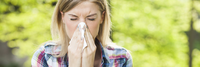 Picture of a woman sneezed using her handkerchief.
