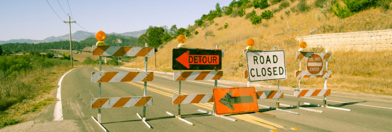 Detour road closed and no entry signs on highway in California