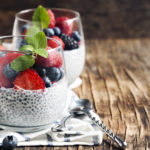 A shot of 2 Chia seed pudding with berries